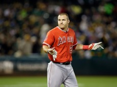 OAKLAND, CA - SEPTEMBER 22:  Mike Trout #27 of the Los Angeles Angels of Anaheim reacts after striking out against the Oakland Athletics at O.co Coliseum on September 22, 2014 in Oakland, California.  (Photo by Ezra Shaw/Getty Images)