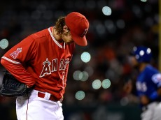 ANAHEIM, CA - APRIL 25:  C.J. Wilson #33 of the Los Angeles Angels of Anaheim reacts after giving up a walk in the sixth inning against the Texas Rangers at Angel Stadium of Anaheim on April 25, 2015 in Anaheim, California.  (Photo by Lisa Blumenfeld/Getty Images)
