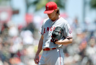 SAN FRANCISCO, CA - MAY 03: Jered Weaver #36 of the Los Angeles Angels of Anaheim looks down at the ground after giving up a solo home run to Joe Panik #12 of the San Francisco Giants in the bottom of the first inning at AT&T Park on May 3, 2015 in San Francisco, California. Weaver gave up back to back solo home runs in the inning one to Nori Aoki, and the second to Panik. (Photo by Thearon W. Henderson/Getty Images)