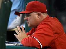 ANAHEIM, CA - MAY 09:  Manager Mike Scioscia of the Los Angeles Angels of Anaheim looks on from the dugout during the game against the Houston Astros at Angel Stadium of Anaheim on May 9, 2015 in Anaheim, California.  (Photo by Lisa Blumenfeld/Getty Images)