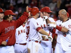 ANAHEIM, CA - MAY 13:   Albert Pujols #5 of the Los Angeles Angels of Anaheim celebrates with teammates after driving in the winning run to defeat  the Colorado Rockies 2-1 in 11 innings at Angel Stadium of Anaheim on May 13, 2015 in Anaheim, California.  (Photo by Lisa Blumenfeld/Getty Images)