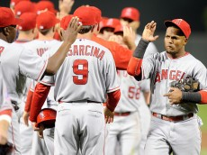 BALTIMORE, MD - MAY 15:  Erick Aybar #2 of the Los Angeles Angels celebrates with teammates after a 3-1 victory against the Baltimore Orioles at Oriole Park at Camden Yards on May 15, 2015 in Baltimore, Maryland.  (Photo by Greg Fiume/Getty Images)