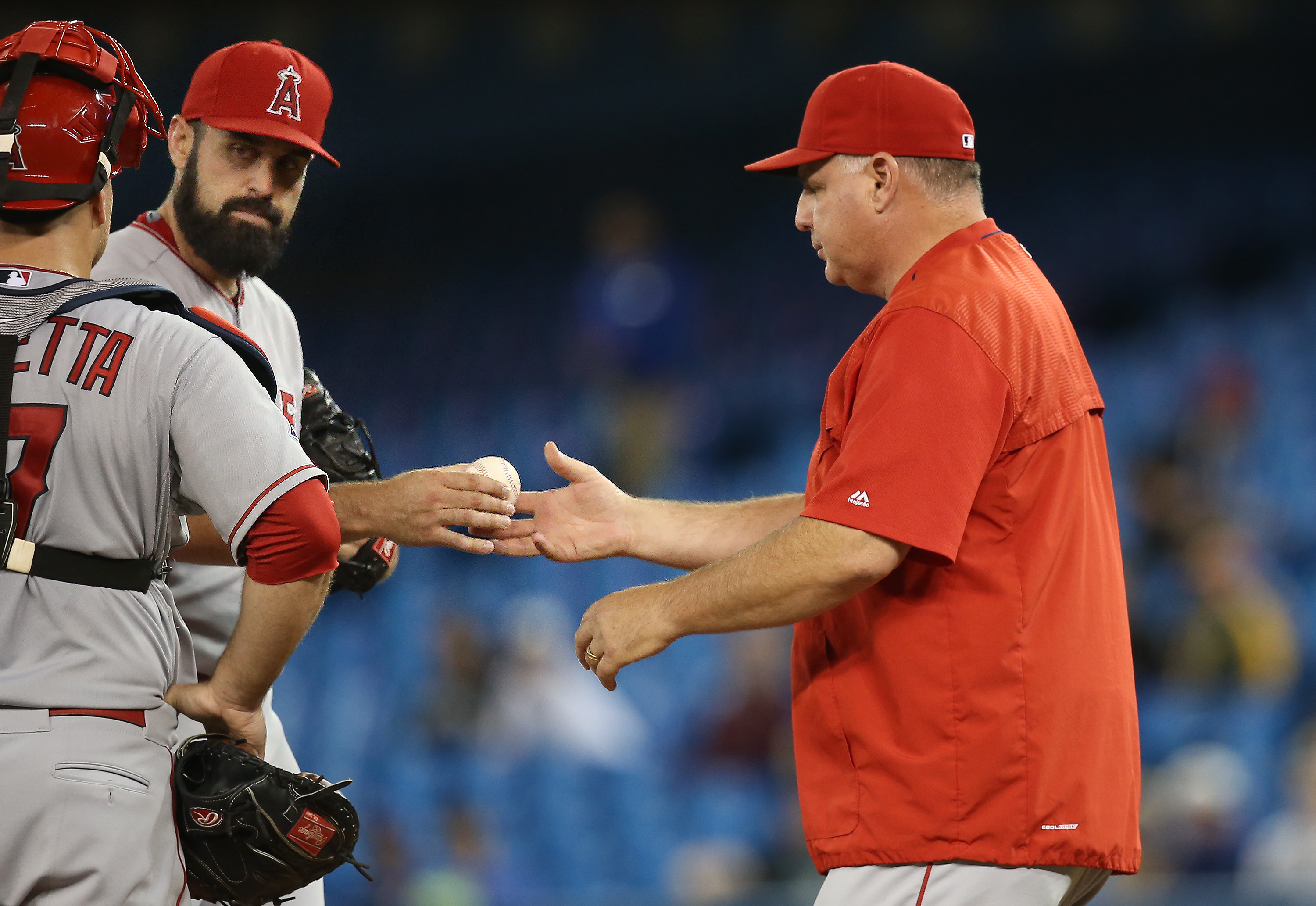 TORONTO, CANADA - MAY 21: Matt Shoemaker #52 of the Los Angeles Angels of Anaheim exits the game as he is relieved by manager Mike Scioscia #14 in the seventh inning during MLB game action against the Toronto Blue Jays on May 21, 2015 at Rogers Centre in Toronto, Ontario, Canada. (Photo by Tom Szczerbowski/Getty Images) *** Local Caption *** Matt Shoemaker; Mike Scioscia