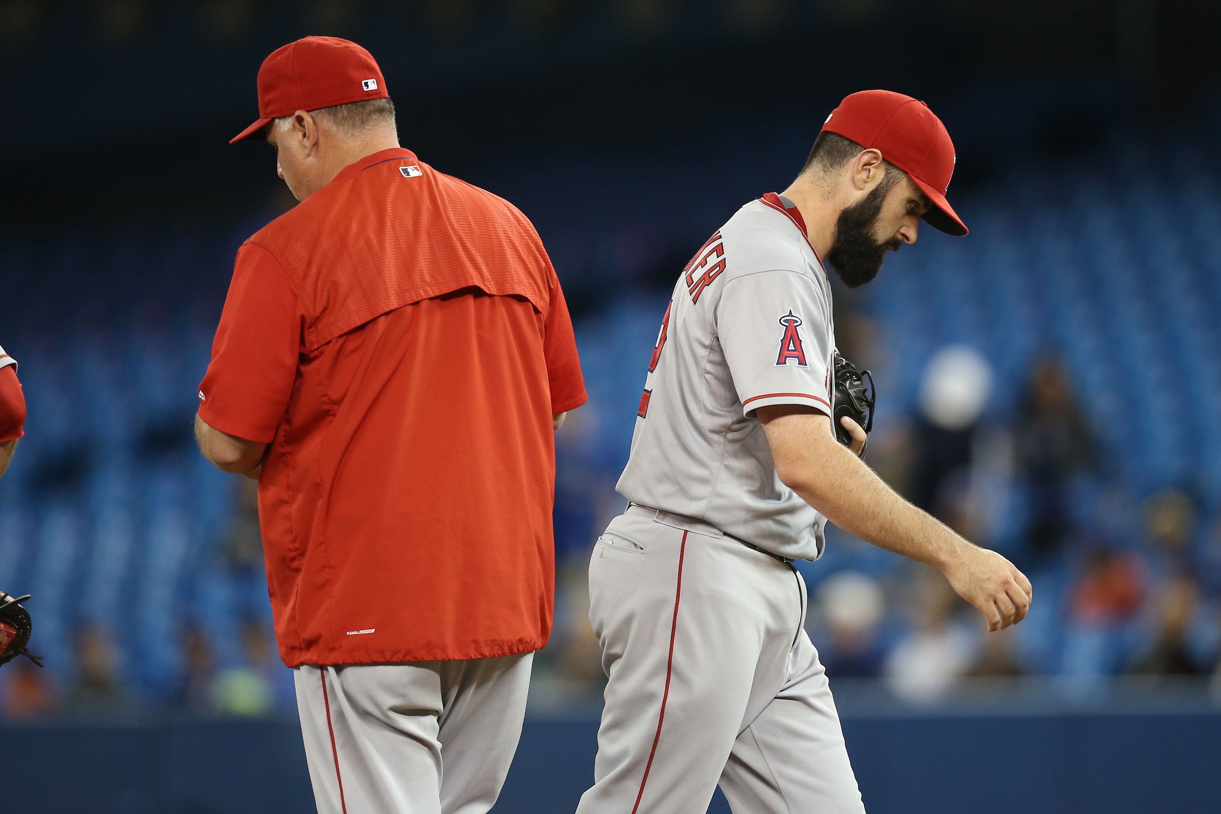 TORONTO, CANADA - MAY 21: Matt Shoemaker #52 of the Los Angeles Angels of Anaheim exits the game as he is relieved by manager Mike Scioscia #14 in the seventh inning during MLB game action against the Toronto Blue Jays on May 21, 2015 at Rogers Centre in Toronto, Ontario, Canada. (Photo by Tom Szczerbowski/Getty Images)