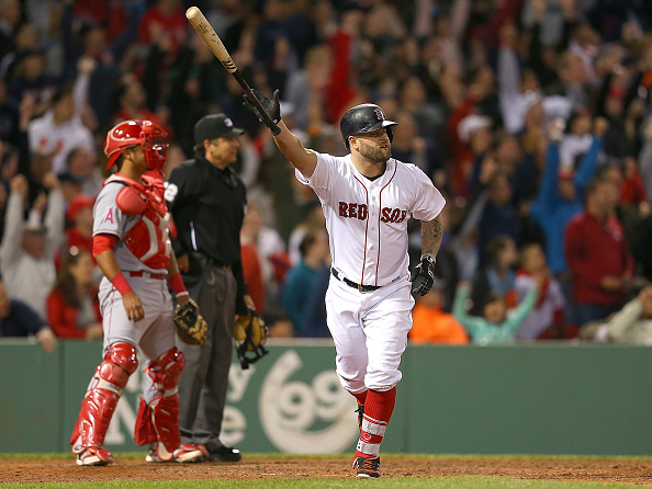 BOSTON, MA - MAY 23: Mike Napoli #12 of the Boston Red Sox hits his second home run of the game against the Los Angeles Angels in the sixth inning at Fenway Park on May 23, 2015 in Boston, Massachusetts. (Photo by Jim Rogash/Getty Images)
