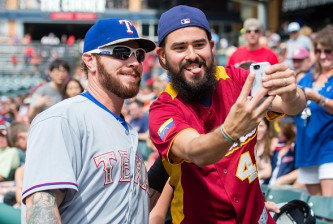 CLEVELAND, OH -  MAY 25: Josh Hamilton #32 of the Texas Rangers takes a selfie with a fan prior to the game against the Cleveland Indians at Progressive Field on May 25, 2015 in Cleveland, Ohio. (Photo by Jason Miller/Getty Images)