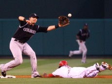 ANAHEIM, CA - JUNE 24:  Erick Aybar #2 of the Los Angeles Angels of Anaheim steals second base as the ball gets past shortstop Troy Tulowitzki #2 of the Colorado Rockies during the second inning at Angel Stadium on June 24, 2009 in Anaheim, California. The Angels defeated the Rockies 11-3.  (Photo by Jeff Gross/Getty Images)