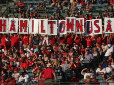 ANAHEIM, CA - JULY 04:  Fans hold up a Hamiltown USA sign in honor of Josh Hamilton #32 of the Los Angeles Angels of Anaheim during the game against  the St. Louis Cardinals at Angel Stadium of Anaheim on July 4, 2013 in Anaheim, California. The Angels defeated the Cardinals 6-5.  (Photo by Jeff Gross/Getty Images)