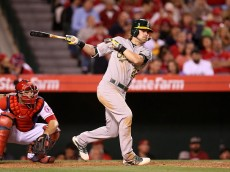 ANAHEIM, CA - APRIL 22: Josh Reddick #22 of the Oakland Athletics hits a double in the seventh inning against the Los Angeles Angels of Anaheim at Angel Stadium of Anaheim on April 22, 2015 in Anaheim, California.  (Photo by Stephen Dunn/Getty Images)