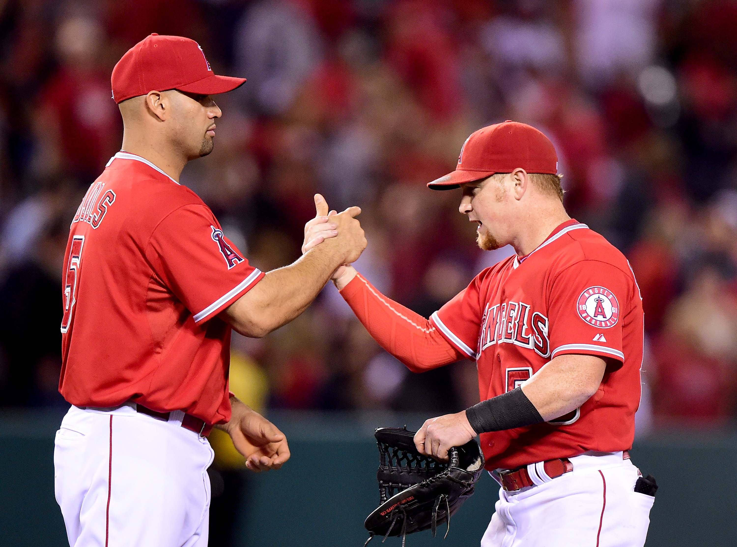 ANAHEIM, CA - JUNE 13:  Albert Pujols #5 of the Los Angeles Angels celebrates a 1-0 win over the Oakland Athletics with Kole Calhoun #56 at Angel Stadium of Anaheim on June 13, 2015 in Anaheim, California.  (Photo by Harry How/Getty Images)