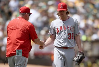 OAKLAND, CA - JUNE 20:  Manager Mike Scioscia #14 of the Los Angeles Angels of Anaheim takes the ball from pitcher Jered Weaver #36, taking him out of the game against the Oakland Athletics in the bottom of the sixth inning at O.co Coliseum on June 20, 2015 in Oakland, California.  (Photo by Thearon W. Henderson/Getty Images)