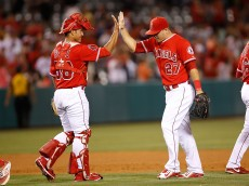ANAHEIM, CA - JUNE 22: Carlos Perez #58 of the Los Angeles Angels and Mike Trout #27 of the Los Angeles Angels celebrate their 4-3 win over the Houston Astros at Angel Stadium of Anaheim on June 22, 2015 in Anaheim, California.  (Photo by Joe Scarnici/Getty Images)