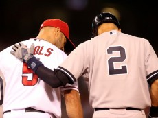ANAHEIM, CA - MAY 05: Derek Jeter #2 of the New York Yankees greets first baseman Albert Pujols #5 of the Los Angeles Angels of Anaheim at first base after Jeter's fourth inning single at Angel Stadium of Anaheim on May 5, 2014 in Anaheim, California.  (Photo by Stephen Dunn/Getty Images)