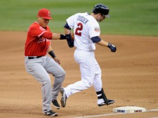MINNEAPOLIS, MN - SEPTEMBER 4: Efren Navarro #19 of the Los Angeles Angels of Anaheim tags out Brian Dozier #2 of the Minnesota Twins at first base during the first inning of the game on September 4, 2014 at Target Field in Minneapolis, Minnesota. (Photo by Hannah Foslien/Getty Images)