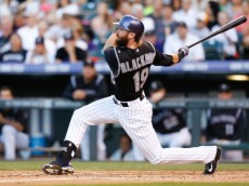 DENVER, CO - AUGUST 23:  Charlie Blackmon #19 of the Colorado Rockies hits a double against the Miami Marlins at Coors Field on August 23, 2014 in Denver, Colorado. The Rockies defeated the Marlins 5-4 in 13 innings.  (Photo by Trevor Brown, Jr./Getty Images)
