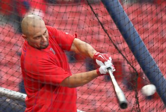 BOSTON, MA - MAY 5: Shane Victorino #18 of the Boston Red Sox takes batting practice before a game with the Tampa Bay Rays at Fenway Park May 5, 2015 in Boston, Massachusetts.  (Photo by Jim Rogash/Getty Images)