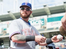 CLEVELAND, OH -  MAY 25: Josh Hamilton #32 of the Texas Rangers signs autographs prior to the game against the Cleveland Indians at Progressive Field on May 25, 2015 in Cleveland, Ohio. The Rangers defeated the Indians 10-8. (Photo by Jason Miller/Getty Images)  *** Local Caption *** Josh Hamilton