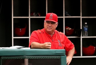 ANAHEIM, CA - JULY 01:  Manager Mike Scioscia of the Los Angeles Angels of Anaheim looks on in the game against the New York Yankees at Angel Stadium of Anaheim on July 1, 2015 in Anaheim, California.  (Photo by Stephen Dunn/Getty Images)