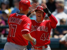 SEATTLE, WA - JULY 12: Chris Iannetta #17 of the Los Angeles Angels of Anaheim is congratulated by Daniel Robertson #44 after hitting a two-run homer in the sixth inning against the Seattle Mariners at Safeco Field on July 12, 2015 in Seattle, Washington. The Angels defeated the Mariners 10-3. (Photo by Otto Greule Jr/Getty Images)
