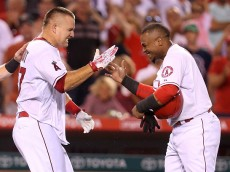 ANAHEIM, CA - JULY 17:  Mike Trout #27 (L) and Erick Aybar #2 of the Los Angeles Angels of Anaheim celebrate after Trout's walk off home run in the ninth inning against the Boston Red Sox at Angel Stadium of Anaheim on July 17, 2015 in Anaheim, California.  The Angels won 1-0.  (Photo by Stephen Dunn/Getty Images)