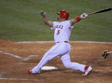 ANAHEIM, CA - JULY 20:  Albert Pujols #5 of the Los Angeles Angels of Anaheim hits a home run during game two of a double header against the Boston Red Sox at Angel Stadium of Anaheim on July 20, 2015 in Anaheim, California.  (Photo by Jonathan Moore/Getty Images)