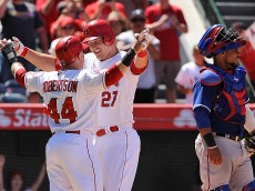 ANAHEIM, CA - JULY 26:  Mike Trout #27 of the Los Angeles Angels of Anaheim celebrates with Daniel Robertson #44 after hitting a grand slam home run in the sixth inning during a game against the Texas Rangers at Angel Stadium of Anaheim on July 26, 2015 in Anaheim, California.  (Photo by Jonathan Moore/Getty Images)