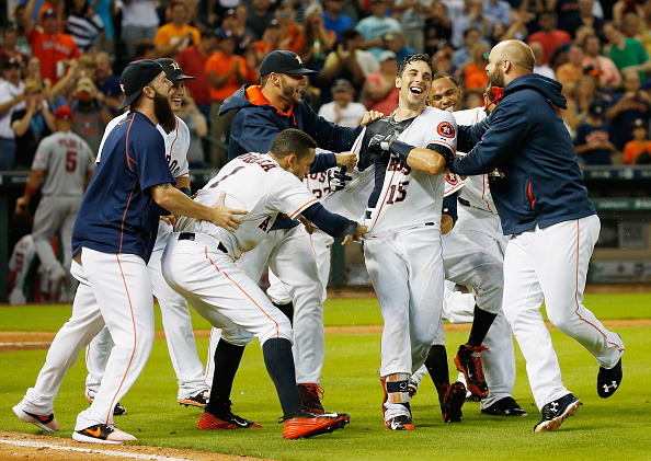 HOUSTON, TX - JULY 30:  Jason Castro #15 of the Houston Astros (C) is mobbed by his teammates after hitting a three-run home run in the ninth inning to end the game and defeat the Los Angeles Angels of Anaheim 3-0 during their game at Minute Maid Park on July 30, 2015 in Houston, Texas.  (Photo by Scott Halleran/Getty Images)