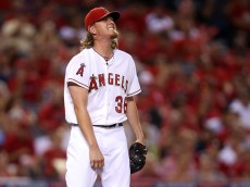 ANAHEIM, CA - OCTOBER 02: Jered Weaver #36 of the Los Angeles Angels reacts after walking Mike Moustakas #8 of the Kansas City Royals in the third inning during Game One of the American League Division Series at Angel Stadium of Anaheim on October 2, 2014 in Anaheim, California.  (Photo by Jeff Gross/Getty Images)