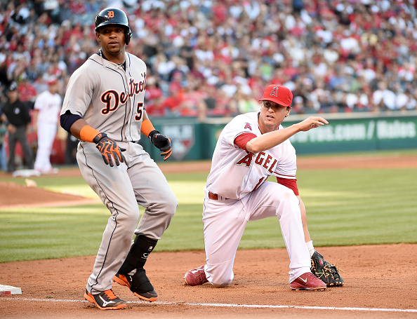 ANAHEIM, CA - MAY 31:  Grant Green #10 of the Los Angeles Angels reacts to a throwing error by Johnny Giavotella #12 allowing Yoenis Cespedes #52 of the Detroit Tigers to reach base during the sixth inning at Angel Stadium of Anaheim on May 31, 2015 in Anaheim, California.  (Photo by Harry How/Getty Images)