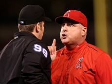 ANAHEIM, CA - JUNE 12:  Manager Mike Scioscia of the Los Angeles Angels of Anaheim argues with first base umpire Chris Conroy after Johnny Giavotella was called out at first in the sixth inning against the Oakland Athletics at Angel Stadium of Anaheim on June 12, 2015 in Anaheim, California.  Scioscia was ejected during the exchange.  (Photo by Stephen Dunn/Getty Images)
