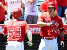 ANAHEIM, CA - AUGUST 05:  Mike Trout #27 of the Los Angeles Angels celebrates a solo homerun from Kole Calhoun #56 to tie the game 1-1 with the Cleveland Indians during the fourth inning at Angel Stadium of Anaheim on August 5, 2015 in Anaheim, California.  (Photo by Harry How/Getty Images)