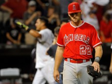 CHICAGO, IL - AUGUST 12:  Conor Gillaspie #22 of the Los Angeles Angels of Anaheim walks off the field after Avisail Garcia #26 of the Chicago White Sox (not pictured) hit a walkoff one run RBI double during the thirteenth inning at U.S. Cellular Field on August 12, 2015 in Chicago, Illinois. The Chicago White Sox won 3-2 in thirteen innings.  (Photo by Jon Durr/Getty Images)