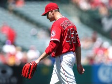 ANAHEIM, CA - AUGUST 23:  Starting pitcher Garrett Richards #43 of the Los Angeles Angels of Anaheim walks to the dugout after giving up three runs and the lead in the third inning aganst the Toronto Blue Jays at Angel Stadium of Anaheim on August 23, 2015 in Anaheim, California.  (Photo by Stephen Dunn/Getty Images)