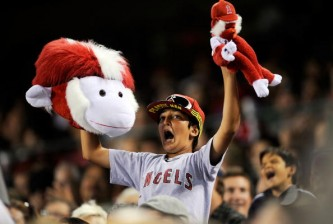 ANAHEIM, CA - JULY 23:  A fan holds up his rally monkeys in support of  the Los Angeles Angels of Anaheim in the sixth inning of the baseball game against the Minnesota Twins on July 23, 2009 in Anaheim, California.  (Photo by Kevork Djansezian/Getty Images)