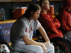 Los Angeles Angels pitcher Jered Weaver sits on the bench after being removed during the sixth inning of a baseball game against the Detroit Tigers on Tuesday, Aug. 25, 2015, in Detroit. (AP Photo/Paul Sancya)