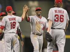 SEATTLE - JUNE 14:  Torii Hunter #48 (C) of the Los Angeles Angels of Anaheim celebrates with Andrew Romine #18 and Jered Weaver #36 after Weaver threw a complete game shutout against the Seattle Mariners at Safeco Field on June 14, 2011 in Seattle, Washington. (Photo by Otto Greule Jr/Getty Images)