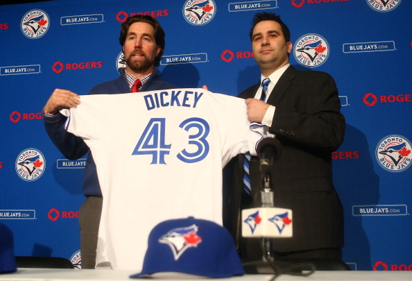 TORONTO, CANADA - JANUARY 8: R.A. Dickey #43 (L) of the Toronto Blue Jays is introduced at a press conference as he is presented with a jersey from general manager Alex Anthopoulos at Rogers Centre on January 8, 2013 in Toronto, Ontario, Canada. (Photo by Tom Szczerbowski/Getty Images)