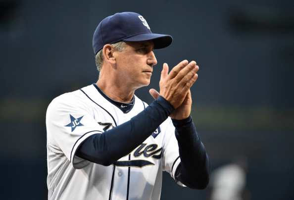 SAN DIEGO, CA - AUGUST 26:  Bud Black #20 manager of the San Diego Padres claps during a ceremony before a baseball game against the Milwaukee Brewers at Petco Park August, 26, 2014 in San Diego, California.  (Photo by Denis Poroy/Getty Images)