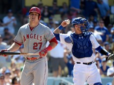 LOS ANGELES, CA - AUGUST 01:  Mike Trout #27 of the Los Angeles Angels reacts after his strikeout in front of of Yasmani Grandal #9 of the Los Angeles Dodgers during the ninth inning at Dodger Stadium on August 1, 2015 in Los Angeles, California.  (Photo by Harry How/Getty Images)