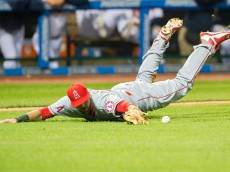 CLEVELAND, OH - AUGUST 28: Third baseman Kaleb Cowart #41 of the Los Angeles Angels of Anaheim dives for a pound ball hit by Jose Ramirez #11 of the Cleveland Indians during the seventh inning at Progressive Field on August 26, 2015 in Cleveland, Ohio. (Photo by Jason Miller/Getty Images)  *** Local Caption *** Kaleb Cowart