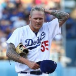 LOS ANGELES, CA - AUGUST 29:  Pitcher Mat Latos #55 of the Los Angeles Dodgers wipes his hair back in the second inning during the MLB game against the Chicago Cubs at Dodger Stadium on August 29, 2015 in Los Angeles, California.  (Photo by Victor Decolongon/Getty Images)