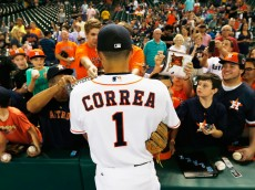 HOUSTON, TX - SEPTEMBER 01:  Carlos Correa #1 of the Houston Astros signs autographs for a fans on the field before the start of their game against the Seattle Mariners at Minute Maid Park on September 1, 2015 in Houston, Texas.  (Photo by Scott Halleran/Getty Images)