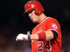 ANAHEIM, CA - SEPTEMBER 04:  C.J. Cron #24 of the Los Angeles Angels of Anaheim celebrates after hitting a two run single in the third inning against the Texas Rangers at Angel Stadium of Anaheim on September 4, 2015 in Anaheim, California  (Photo by Stephen Dunn/Getty Images)
