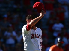 ANAHEIM, CA - SEPTEMBER 13:  Pitcher Huston Street #16 of the Los Angeles Angels of Anaheim wipes his face in the ninth inning during the MLB game against the Houston Astros at Angel Stadium of Anaheim on September 13, 2015 in Anaheim, California.  (Photo by Victor Decolongon/Getty Images)