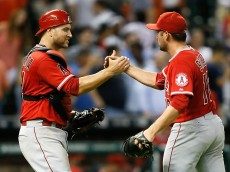 HOUSTON, TX - SEPTEMBER 22:  Chris Iannetta #17 of the Los Angeles Angels of Anaheim gives Huston Street #16 a shake after the last out against the Houston Astros at Minute Maid Park on September 22, 2015 in Houston, Texas.  (Photo by Bob Levey/Getty Images)