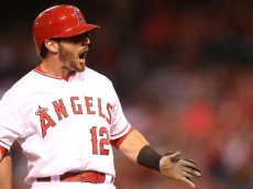 ANAHEIM, CA - SEPTEMBER 26: Johnny Giavotella #12 of the Los Angeles Angels of Anaheim reacts after hitting a triple in the second inning against the Seattle Mariners at Angel Stadium of Anaheim on September 26, 2015 in Anaheim, California.  (Photo by Stephen Dunn/Getty Images)