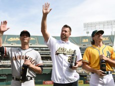 OAKLAND, CA - SEPTEMBER 27:  The Big Three, Barry Zito #75 of the Oakland Athletics (R), former Oakland Athletics Mark Mulder #20 (C) and Tim Hudson #17 of the San Francisco Giants (L) is presented with a bottle of chardonnay wine by the the Oakland Athletics prior to the game at O.co Coliseum on September 27, 2015 in Oakland, California. Zito, Hudson, and Mulders were teammates with the Athletics from 2000-2004. (Photo by Thearon W. Henderson/Getty Images)
