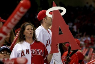 ANAHEIM, CA - OCTOBER 03:  A Los Angeles Angels of Anaheim fan cheers during game two of the American League Division Series against the Boston Red Sox at Angel Stadium on October 3, 2008 in Anaheim, California.  (Photo by Stephen Dunn/Getty Images)