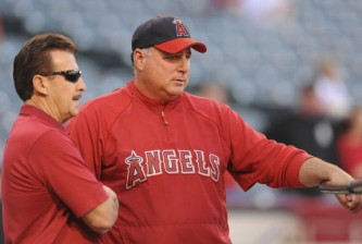ANAHEIM, CA - OCTOBER 08:  Art Moreno (L) owner of Los Angeles Angels of Anaheim and manager Mike Scioscia look on during batting practice before Game One of the ALDS against the Boston Red Sox during the 2009 MLB Playoffs at Angel Stadium on October 8, 2009 in Anaheim, California.  (Photo by Lisa Blumenfeld/Getty Images)
