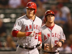 ARLINGTON, TX - SEPTEMBER 11:  (L-R) Mike Trout #27 and Kole Calhoun #56 of the Los Angeles Angels celebrate a run against the Texas Rangers in the third inning at Globe Life Park in Arlington on September 11, 2014 in Arlington, Texas.  (Photo by Ronald Martinez/Getty Images)